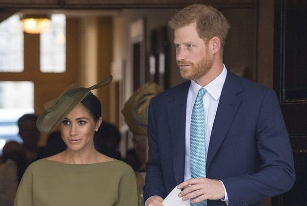 Duchess of Sussex looks elegant as she joins Prince Harry at baby Louis' christening