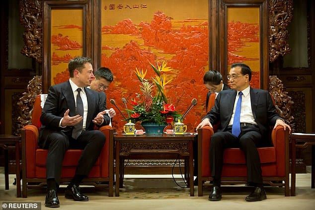 Elon Musk shakes hands with China's premier minister