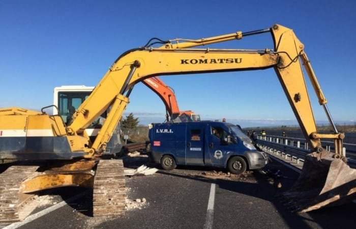 Italian armed gang use diggers to 'rip open' security van