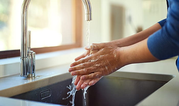 Water containing ozone disinfects hands as well as alcohol-based sanitizer