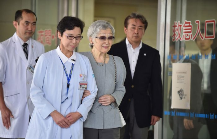 Former Japanese empress Michiko leaves hospital after breast cancer surgery