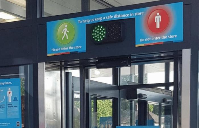 Supermarket installs traffic light system for social distancing