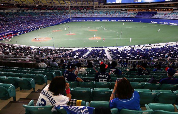 Masked fans return to  stadiums across Japan